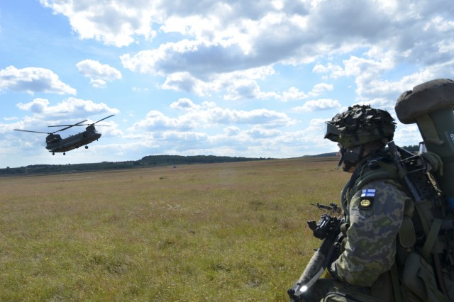 A British Royal Air Force CH-47 helicopter extracts Finnish marines from the Nyland Brigade during a combined U.S.-Finnish air assault mission during BALTOPS 15 here June 10. BALTOPS is an annually recurring multinational exercise designed to enhance flexibility and interoperability, as well as demonstrate resolve of allied and partner forces to defend the Baltic region.  (U.S. Army photo by Sgt. A.M. LaVey/173rd Abn. Bde. Public Affairs)