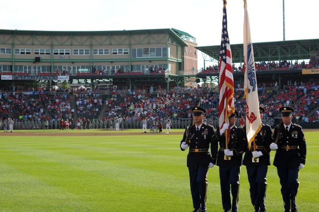The Maneuver Support Center of Excellence Color Guard marches off the field after presenting the colors during the National anthem prior to the Springfield Cardinals Military Appreciation game Saturday. The color guard joined the 399th Army Band and several Soldiers, Sailors and Airmen from Fort Leonard for the pre-game ceremonies.