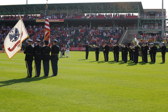 The Maneuver Support Center of Excellence Color Guard and 399th Army Band participate in opening ceremonies before the Springfield Cardinals Military Appreciation game Saturday.