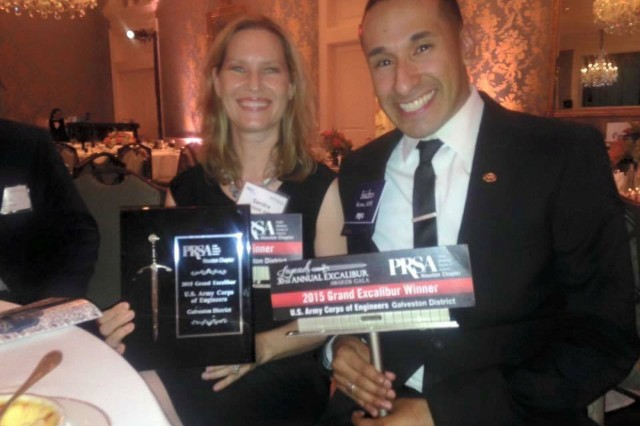 Public Affairs Officers Sandra Arnold, APR+M, and Isidro Reyna, APR, accepted the Public Relations Society of America Houston Chapter's top honor, the 2015 Grand Excalibur Award, on behalf of the USACE Galveston District for its public service campaign to communicate its Dam Safety Program during the 30th Annual Excalibur Awards Gala in Houston June 18, 2015.