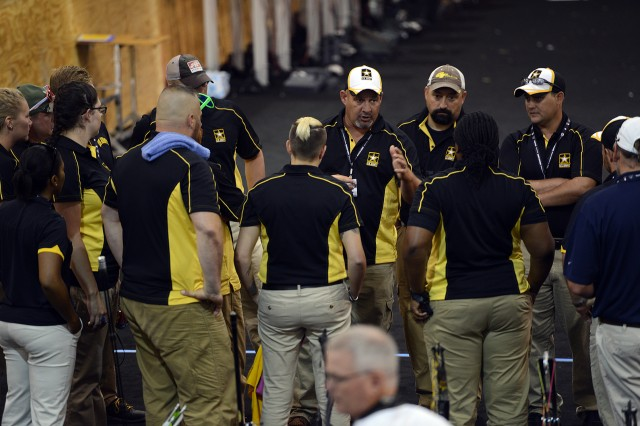 Team Army archery head coach Jessie White, center, gives a pep talk before the archery competition at the 2015 Department of Defense Warrior Games in Quantico, Va., June 22, 2015.