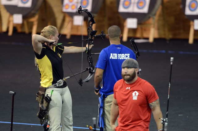 Spc. Chasity Kuczer, left, took home two gold medals in compound bow archery at the 2015 Department of Defense Warrior Games in Quantico, Va., June 22, 2015.