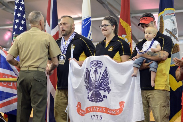 Army veteran Sgt. Sean Hook, Army Reserve Spc. Sydney Davis and Army veteran Staff Sgt. Billy Meeks took gold in team recurve bow archery at the 2015 Department of Defense Warrior Games in Quantico, Va., June 22, 2015.