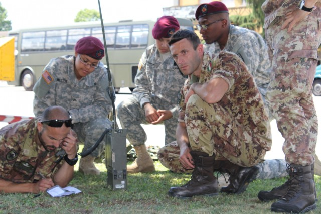 Signaleers, from the 173rd Airborne Brigade and the Italian 8th Parachute Assault Engineer Regiment, communicate over FM frequencies after building a bridging solution during combined radio training in Legnago, Italy, June 16, 2015.