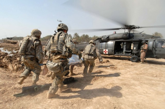 Soldiers transport a trauma victim to an Army medical helicopter in Tarmiyah, Iraq, Sept. 30, 2007. Recent improvements in the delivery of trauma care in-theater have resulted in a case fatality rate of less than 10 percent, down from approximately 16 percent at the onset of Operation Enduring Freedom.