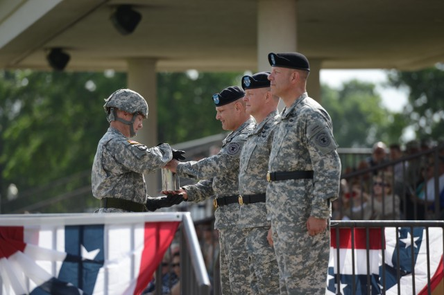 The Salute Battery presents the canister to Maj. Gen. Allen Batschelet, US Army Recruiting Command's outgoing CG, during USAREC's change of command ceremony June 23, 2015, at Fort Knox, Kentucky.
