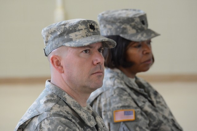 Lt. Col. Eugene Maxwell and Lt. Col. Denise Walker listen as Col John Lamoureux, Eisenhower Army Medical Center Commander, speaks at the Warrior Transition Battalion change of command ceremony on June 19. (DoD Photo by Wesley Elliott, EAMC Public Affairs Officer, U.S. Army/Released)