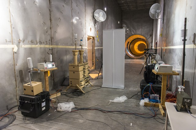 Inside the Active Standoff Chamber inner chamber, where simulated chemical or biological agents are released. Scientists who brought the systems are nearby, monitoring the detector's performance.