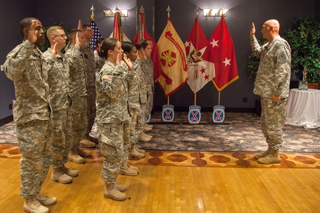 Army Chief of Staff Gen. Ray Odierno administers the oath of enlistment as he reenlists 10 Fort Drum Soldiers after holding a town hall meeting with troops during his visit to Fort Drum, N.Y., June 23, 2015.