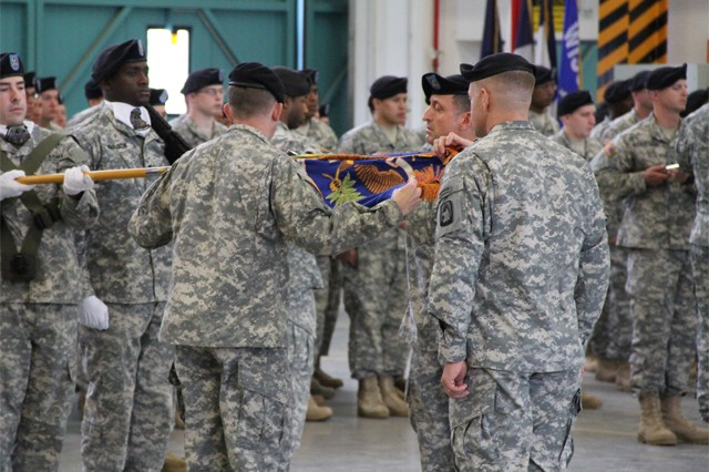 Lt. Col. Mark C. Johnson, the battalion commander for 3rd Bn., 158th Avn. Regt., 12th CAB and Command Sgt. Maj. Paul G. Hutchings, the command sergeant major for the battalion, case their battalion's colors at Katterbach Kaserne, June 24, 2015.  The casing of the battalion colors symbolizes the deactivation of the unit, as part of the U.S. Army's Aviation Restructuring Initiative implemented earlier this year.
