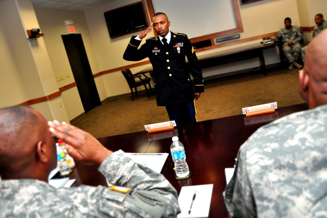 Sgt. Brian Reynolds, U.S. Army Sustainment Command, reports to the president of the board during the Best Warrior Competition at Rock Island Arsenal, Illinois, June 24. Contestants were each required to answer general questions about the Army while presenting themselves as professional Soldiers to a board of five sergeants major. (Photo by Kevin Fleming, ASC Public Affairs)
