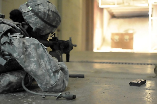 Sgt. 1st Class Annette Simon, Army Field Support Battalion-Qatar, 402nd Army Field Support Brigade, displays her marksmanship on the M-4 rifle at the Keith L. Ware Test and Simulation Center June 23 at Rock Island Arsenal, Illinois. (Photo by Jon Micheal Connor, ASC Public Affairs)