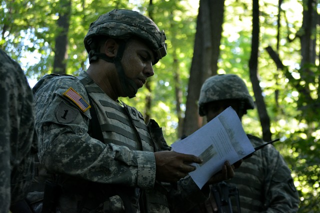 Sgt. 1st Class Rosalio Garza, ASC, navigates through the woods during a situational training exercise as part of ASC's Best Warrior Competition at Rock Island Arsenal, Illinois, June 23. Garza was runner up for ASC's NCO of the year. (Photo by Justin Graff, ASC Public Affairs)