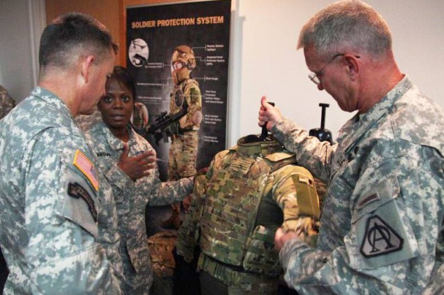 Program Executive Office Soldier shows Army Vice Chief of Staff Gen. Daniel B. Allyn how it is providing Soldiers with more lethal weapons, better protective gear and more capable equipment while also looking for ways to lighten Soldier load during his visit there, June 23, 2015.