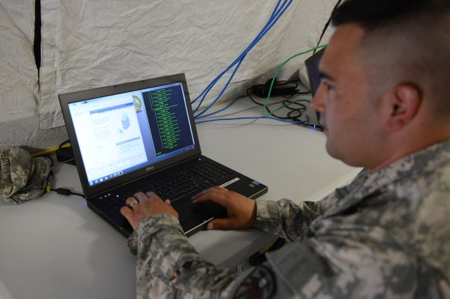 Staff Sgt. Mitchell Pieratt, interactive operator of the 101st Cyber Protection Team, participates in the Joint Users Interoperability Communications Exercise at Aberdeen Proving Ground, Md., June 24, 2015.