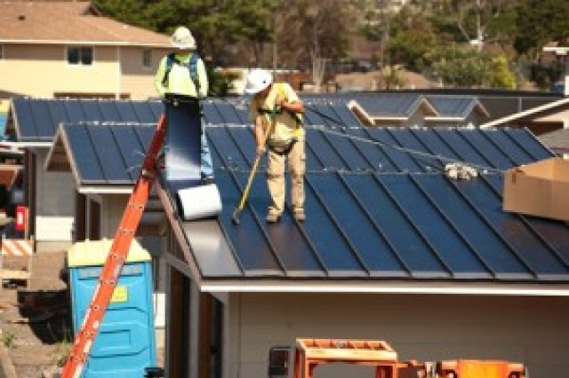Construction continues in Island Palm Commnities' housing neighborhoods to meet renewable energy requirements.
