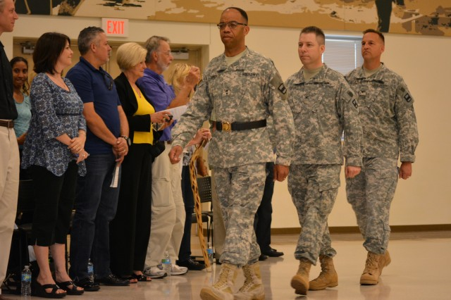 Maj. Gen. A.C. Roper, commander 80th Training Command (TASS), leads the official party during the 800th Logistics Support Brigade's change of command ceremony Mustang, Okla., June 28, 2015. Following Roper; the out going brigade commander Col. Howard C. W. Geck and Col. Bradly M. Boganowski the incoming commander.