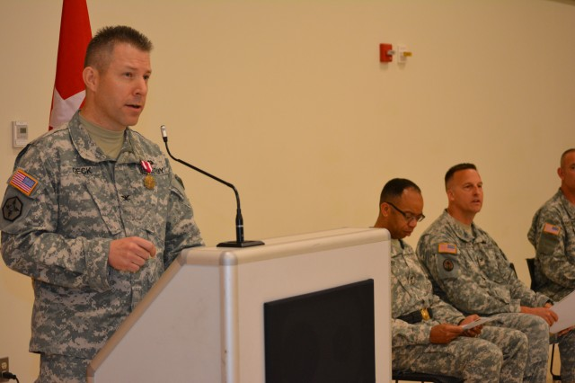 Col. Howard C. W. Geck, former commander, 800th Logistics Support Brigade, delivers his final address to the Soldiers, civilians and family members during a change of command ceremony Mustang, Okla., June 28, 2015. Col. Bradly M. Boganowski replaced Geck as commander.
