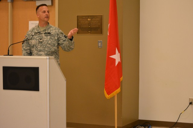 Col. Bradly M. Boganowski addresses the 800th Logistics Support Brigade for the first time as the commander during a change of command ceremony, Mustang, Okla., June 28, 2015. Boganowski replaced Col. Howard C. W. Geck as commander.