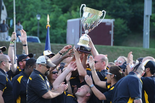 Team Army raises the Chairman's Cup trophy in celebration at the 2015 Department of Defense Warrior Games, June 28, 2015. The Army won the Chairman's Cup after earning 162 medals during the games, earning 141 points towards the Chairman's Cup competition.