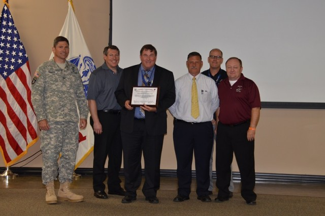 The OH-58D Kiowa Warrior divestment team is recognized with a Certificate of Appreciation from the 3rd Squadron, 17th Cavalry Regiment during the Armed Scout Helicopter change of responsibility June 18.