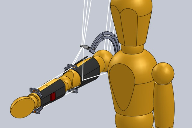 Computer-simulated modeling of the MAXFAS cables, which attach from behind to enable the red sensor to feel and adjust the slightest of arm movement, help the team communicate to human sciences experts the concept of how they would like to improve shooting proficiency.