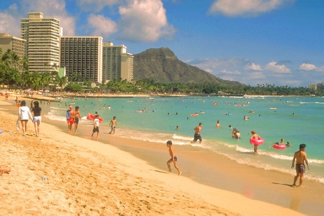 People play at a beach in Honolulu, Hawaii.