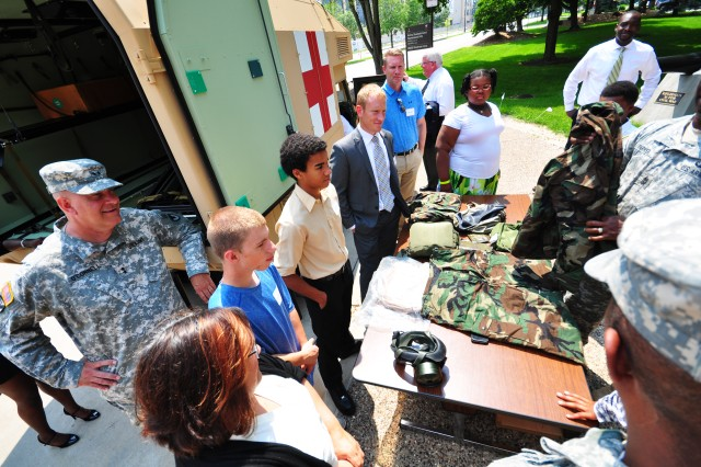 Maj. Gen. Kevin O'Connell, commanding general, U.S. Army Sustainment Command, stands with Littles from the Big Brothers, Big Sisters program as they learn about Army equipment, here, June 30.