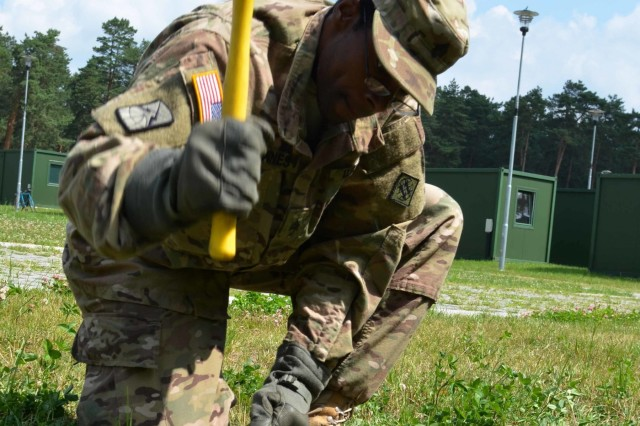 Sgt. Kelvin Bownes, a Soldier assigned to the 44th Expeditionary Signal Battalion, drives in a stake to secure the grounding cable for a Satellite Transportable Terminal June 28, 2015 near Nowa Dęba, Poland. Bownes is part of Operation Atlantic Resolve, an ongoing multinational partnership focused on joint training and security cooperation between NATO allies. (U.S. Army photo by Sgt. Brandon Anderson, 13th Public Affairs Detachment)