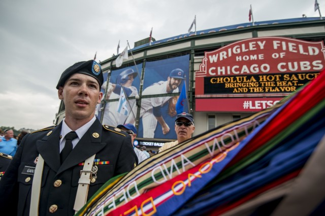 Spc. Travis Gantz, an Army Reserve color guard team member from the 416th Theater Engineer Command, carries the U.S. Army flag after presenting colors at Wrigley Field for a Chicago Cubs game against the Los Angeles Dodgers, June 25. The 416th TEC is headquartered just 30 miles driving distance from Wrigley Field and is responsible for more than 12,000 Army Reserve Soldiers in 27 different states. The color guard team members were Staff Sgt. John Pudowski, Staff Sgt. Timothy Cooper, Sgt. Peter Garcia, Spc. William McGuigan and Spc. Travis Gantz. (U.S. Army photo by Master Sgt. Michel Sauret)