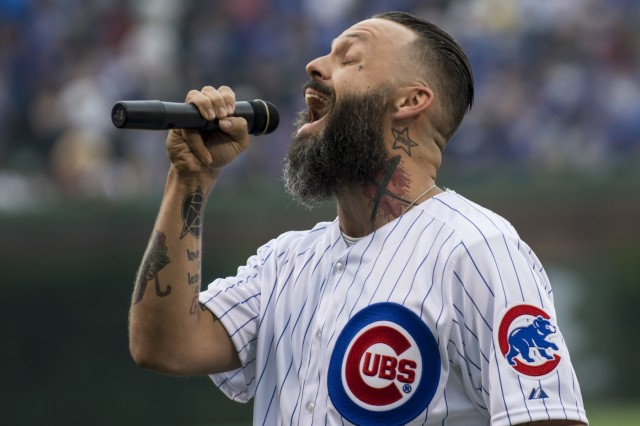 Justin Furstenfeld, lead singer for Blue October, sings the national anthem at Wrigley Field for a Chicago Cubs game against the Los Angeles Dodgers, June 25. The 416th Theater Engineer Command provided a color guard for the game. The 416th TEC is headquartered just 30 miles driving distance from Wrigley Field and is responsible for more than 12,000 Army Reserve Soldiers in 27 different states. The color guard team members were Staff Sgt. John Pudowski, Staff Sgt. Timothy Cooper, Sgt. Peter Garcia, Spc. William McGuigan and Spc. Travis Gantz. (U.S. Army photo by Master Sgt. Michel Sauret)