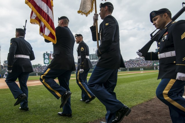 An Army Reserve color guard team from the 416th Theater Engineer Command walks on the field to present the U.S. flag and Army colors during the national anthem at Wrigley Field for a Chicago Cubs game against the Los Angeles Dodgers, June 25. The 416th TEC is headquartered just 30 miles driving distance from Wrigley Field and is responsible for more than 12,000 Army Reserve Soldiers in 27 different states. The color guard team members were Staff Sgt. John Pudowski, Staff Sgt. Timothy Cooper, Sgt. Peter Garcia, Spc. William McGuigan and Spc. Travis Gantz. (U.S. Army photo by Master Sgt. Michel Sauret)