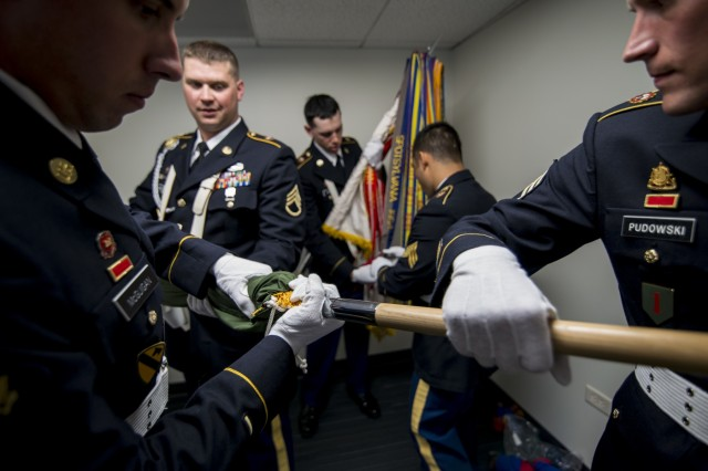 An Army Reserve color guard team from the 416th Theater Engineer Command assembles the U.S. flag and Army colors before presenting at Wrigley Field for a Chicago Cubs game against the Los Angeles Dodgers, June 25. The 416th TEC is headquartered just 30 miles driving distance from Wrigley Field and is responsible for more than 12,000 Army Reserve Soldiers in 27 different states. The color guard team members were Staff Sgt. John Pudowski, Staff Sgt. Timothy Cooper, Sgt. Peter Garcia, Spc. William McGuigan and Spc. Travis Gantz. (U.S. Army photo by Master Sgt. Michel Sauret)