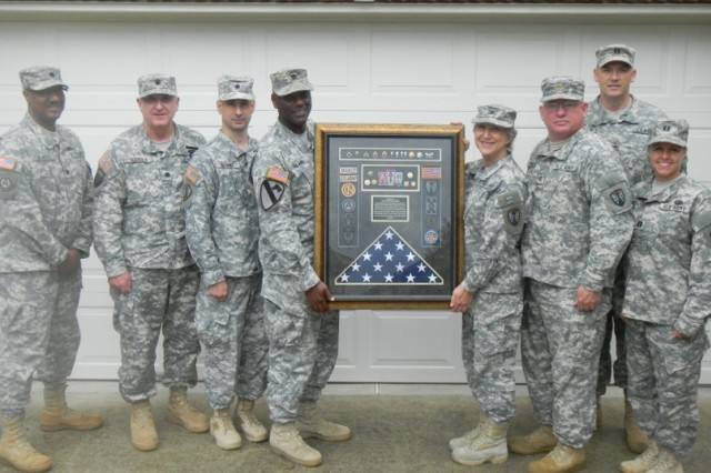 COL Patricia Mance, center right, is honored with a shadow box containing mementoes from her 40-plus years of service. It was presented to her at the 2015 Reserve Component Acquisition Summit in Atlanta in late June. Pictured with her are several Soldiers who worked with Mance in her last assignment as the assistant division acquisition officer and deputy officer-in-charge of the Central Region Team, physically located in Huntsville, under the auspices of the Army Reserve Sustainment Command, headquartered in Birmingham. Pictured are, from left, Lt. Col. Jerry Davis, Lt. Col. Kenneth Arnold, Lt. Col. Kenneth Bryant, Lt. Col. Ronald Clark, Mance, Maj. Steve Morris, Capt. David Borders and Capt. Deborah Robertson.