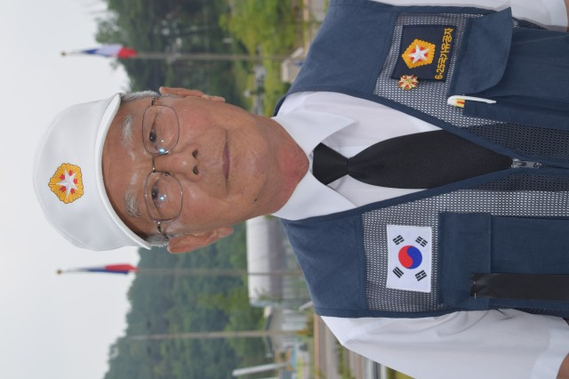 Young Myeon Yeo, a member of the Osan City Korean War veterans association, poses for a photo following an interview about his military service during the Korean War July 2, 2015 at Jukmiryeong War monument. Yeo served with a signal brigade under I Corps. (Photo by U.S. Army Staff Sgt. Heather A. Denby, 35th ADA Public Affairs)