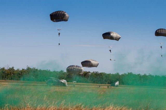 Service members, from 4th Brigade Combat Team, 25th Infantry Division, parachute onto the Kapyong Air Field, Australia, in support of Exercise Talisman Sabre 15, July 8, 2015.