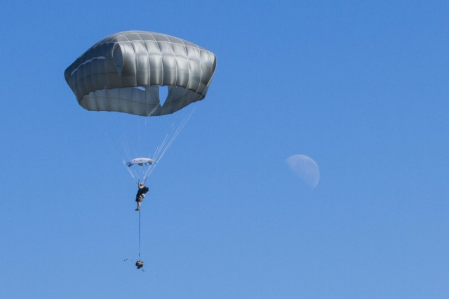 A Soldier, from 4th Brigade Combat Team, 25th Infantry Division, parachutes onto the Kapyong Air Field, Australia, in support of Exercise Talisman Sabre 15, July 8, 2015.