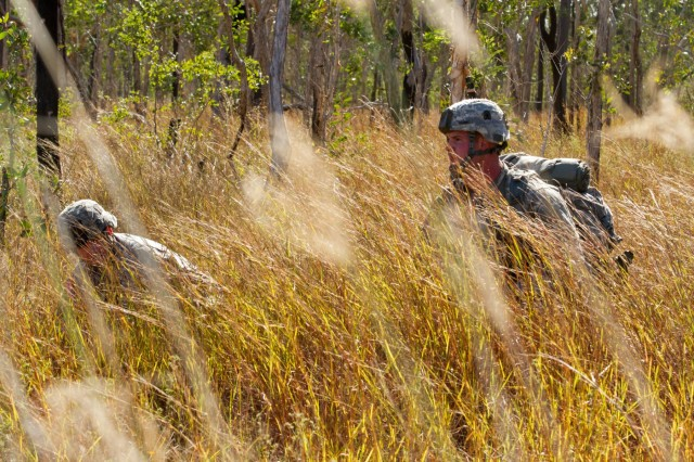 Service members, from 4th Brigade Combat Team, 25th Infantry Division, set up a security perimeter after parachuting onto Kapyong Air Field, Australia, in support of Exercise Talisman Sabre 15, July 8, 2015.