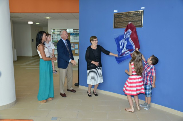 The families of 1st Lt. Donald Judd and Sgt. 1st Class Daniel Metcalfe unveil a plaque named in honor of their loved ones July 8, 2015 during a building dedication ceremony by the 173rd Airborne Brigade at Caserma Del Din, Vicenza, Italy. The building is named after the two paratroopers from the brigade, posthumously awarded the Silver Star for Valor: Judd, killed in Vietnam in 1967 and Metcalfe, killed in Afghanistan in 2012. (U.S. Army photo by Visual Information Specialist Paolo Bovo/Released)