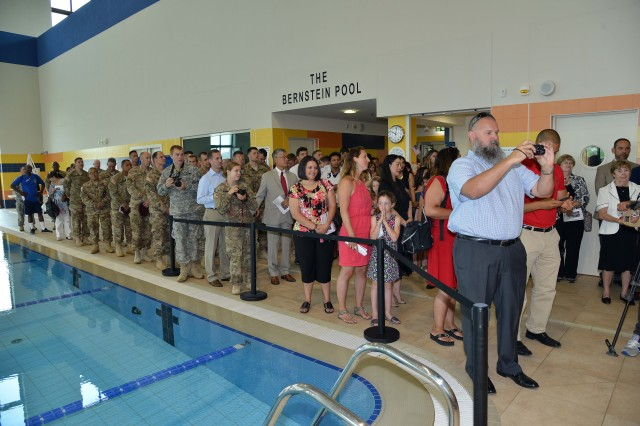 Families, friends and paratroopers of the 173rd Airborne Brigade attend the unveiling of a plaque honoring 1st Lt. David Bernstein July 8, 2015 during a building dedication ceremony by the 173rd Airborne Brigade at Caserma Del Din, Vicenza, Italy. The swimming pool in the Judd-Metcalfe Fitness Center was named in honor of Bernstein, a paratrooper from the brigade posthumously awarded the Silver Star for valor in Iraq in 2003. (U.S. Army photo by Visual Information Specialist Paolo Bovo/Released)