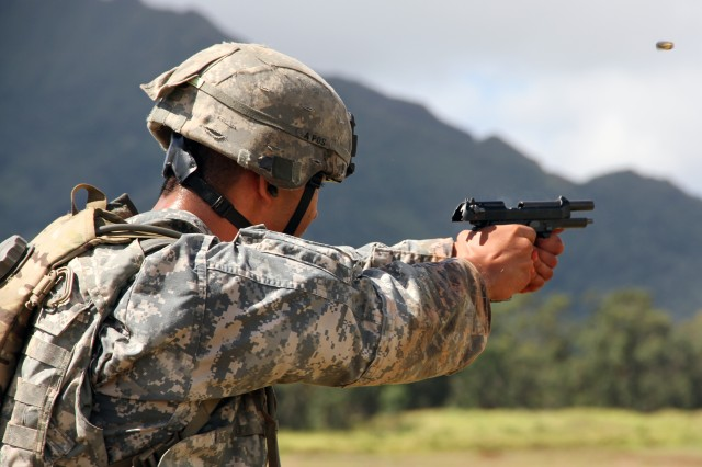 Sgt. Dave Salvador, of 75th Medical Company Area Support, South Korea, shoots his M9 during the Stress Shoot Qualification Lane of the Pacific Regional Medical Command Best Medic Competition, Sept. 21-25, 2014, at Schofield Barracks, Hawaii. The Army is looking for a new pistol to replace the M9.