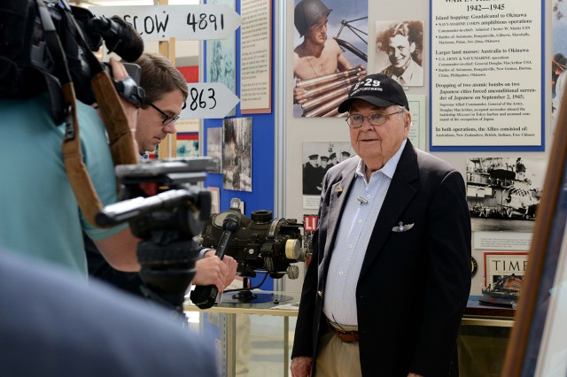 Retired Lt. Col. Bob Vaucher, who served as a U.S. Army Air Corps pilot from 1940-1946, speaks with reporters at the Arsenal of Democracy Flyover test flight at Manassas Regional Airport in Virgina, May 7, 2015. Vaucher, 96, flew 117 missions during World War II and led the largest inland bombing mission in the Pacific Theater.