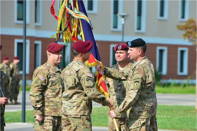 173rd Airborne Brigade Commander Col. Gregory Anderson (center) receives the brigade colors from U.S. Army Europe Commanding General Lt. Gen. Ben Hodges (right) July 9, 2015 during the brigade change of command ceremony at Caserma Del Din, Vicenza, Italy. The 173rd Airborne Brigade is the Army Contingency Response Force, capable of providing ready forces across the U.S. European, Africa and Central Commands areas of responsibility.  (U.S. Army photo by Visual Information Specialist Paolo Bovo/released)