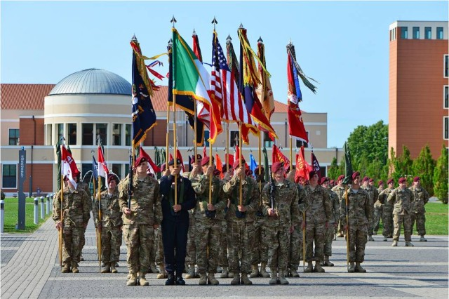 Paratroopers from the U.S. Army's 173rd Airborne Brigade and a soldier from the Italian Carabinieri present the national flags of Italy and the United States, as well as the colors of the 173rd Airborne Brigade and its battalions, companies, batteries and troops July 9, 2015 during the brigade change of command ceremony at Caserma Del Din, Vicenza, Italy. The 173rd Airborne Brigade is the Army Contingency Response Force, capable of providing ready forces across the U.S. European, Africa and Central Commands areas of responsibility.  (U.S. Army photo by Visual Information Specialist Paolo Bovo/released)