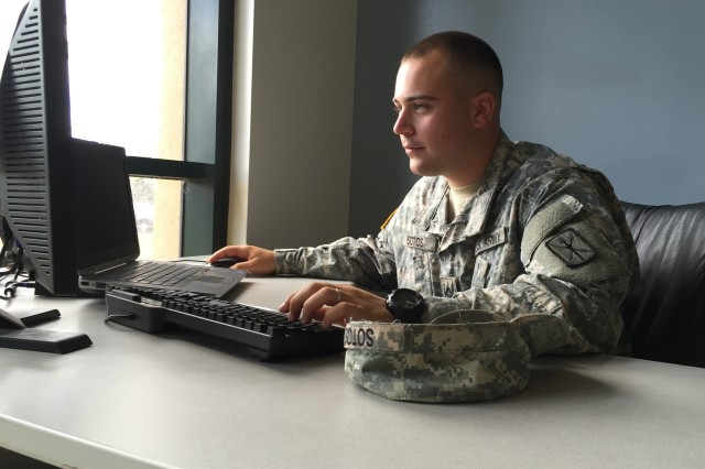 Pfc. Dimitris Sotos, assigned to the 30th Signal Battalion, develops training slides using Microsoft Office 2013, at Scholfield Barracks, HI, on June 10, 2015.