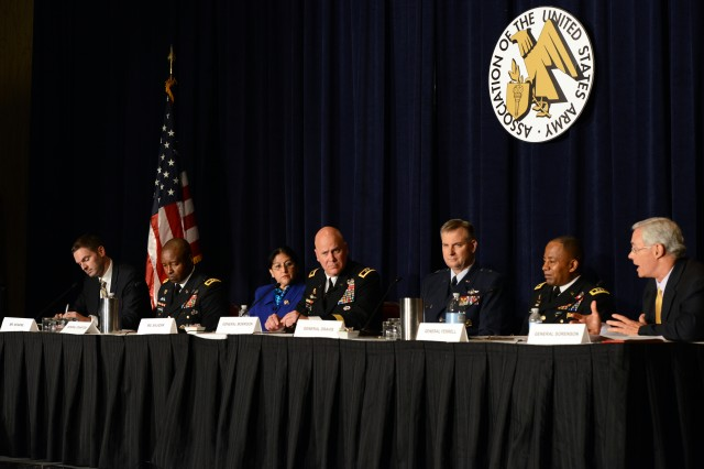 Panelists speak on the topic of the joint information environment. From left, Christoper Kearns of Lockheed Martin; Maj. Gen. Bruce T. Crawford, commanding general, U.S. Army Communications-Electronics Command; Teresa M. Salazar of the Air Force; Maj. Gen. John B. Morrison, Jr., commanding general, U.S. Army Network Enterprise Technology Command; Brig. Gen. Brian T. Dravis, Air Force; panel chair Lt. Gen. Robert S. Ferrell, chief information officer, G-6; and panel moderator retired Lt. Gen. Jeffrey Sorenson.