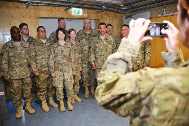 U.S. Army Chief of Staff Gen. Ray Odierno, center, smiles for a photo among Soldiers, assigned to the 4th Infantry Division, at the 7th Army Joint Multinational Training Command's Grafenwoehr Training Area, Germany, July 9, 2015.
