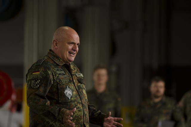 Sgt. Maj. Klaus Meyer from the Bundeswehr-Reservisten (German Armed Forces) addresses the formation of US Soldiers at Shipton Kaserne, Ansbach, Germany, July 13, 2015, as part of the German Armed Forces proficiency badge award ceremony given to Soldiers from the 412th ASB, 12th Combat Aviation Brigade.  (U.S. Army photo by Sgt. Thomas Mort, 12th CAB)