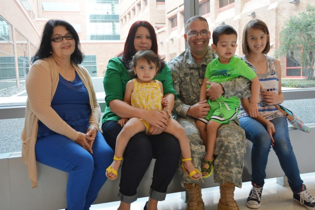 The Collado family poses for a photo at San Antonio Military Medical Center, July 7, 2015. From left, Maria Hernandez, Alma Collado, 1-year-old Adriana, Army Maj. Jose Collado, Jose Jr., and 11-year-old Melissa.