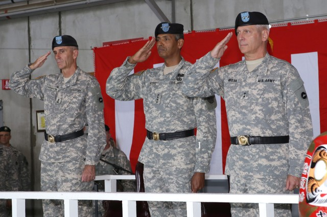 Incoming U.S. Army Japan and I Corps (Forward) Commander, Maj. Gen. James F. Pasquarette, U.S. Army Pacific Commander, Gen. Vincent K. Brooks, and Outgoing USARJ Commander, Maj. Gen. James C. Boozer, Sr., salute during a change of command ceremony held July 8 at Kastner Army Airfield Hanger.